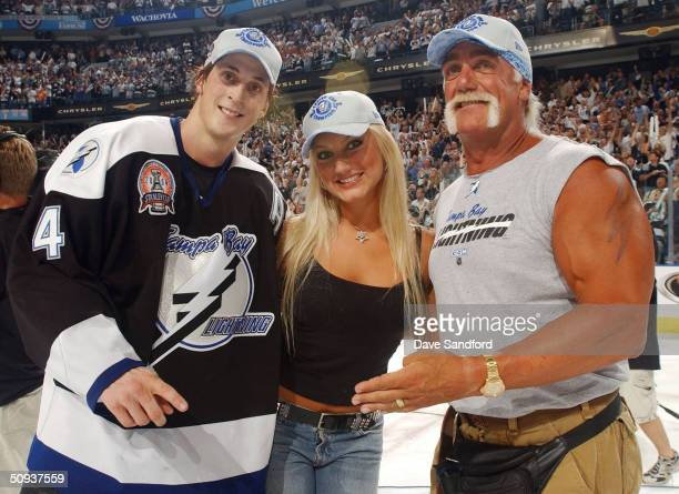 Vincent Lecavalier of the Tampa Bay Lightning poses with professional wrestler Hulk Hogan and daughter Brooke after defeating the Calgary Flames 21...