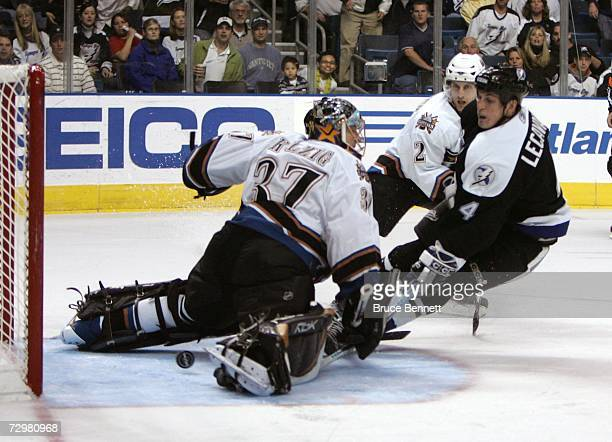 Vincent Lecavalier of the Tampa Bay Lightning scores in the second period against goaltender Olie Kolzig of the Washington Capitals at the St Pete...
