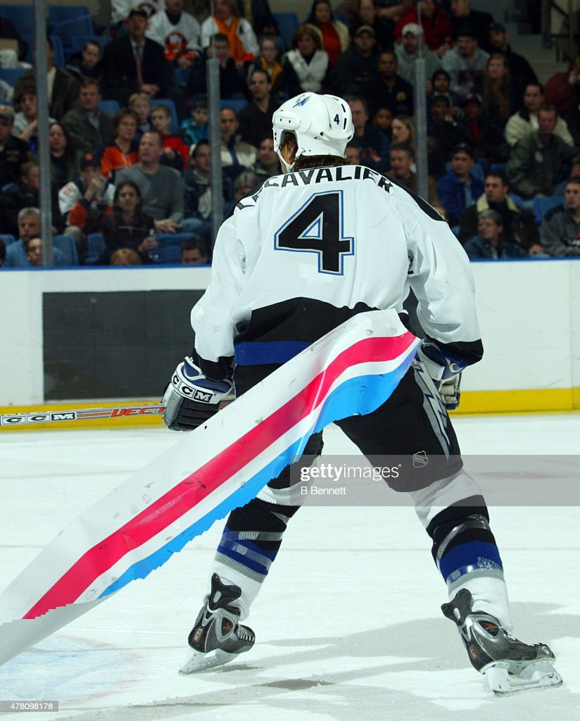 Vincent Lecavalier #4 of the Tampa Bay Lightning skates with a piece of board advertising attached to his pants against the New York Islanders on December 9, 2003 the the Nassau Coliseum in Uniondale, New York.