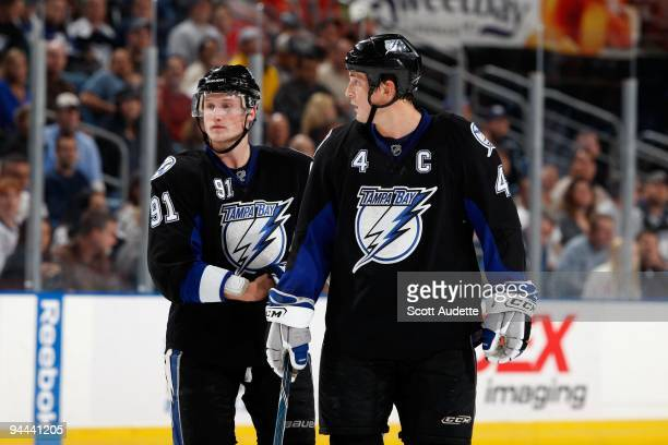Vincent Lecavalier of the Tampa Bay Lightning talks with teammate Steven Stamkos during a break in the play against the Washington Capitals at the St...