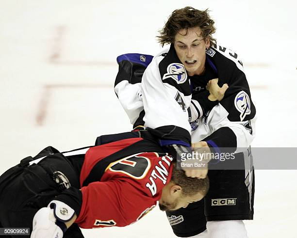 Vincent Lecavalier of the Tampa Bay Lightning throws a punch at Jarome Iginla of the Calgary Flames during a fight in the first period in game three...