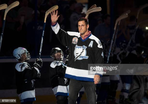 Vincent Lecavalier waves to fans as the Tampa Bay Lightning honor the 2004 Stanley Cup Champions as part of their 25th anniversary celebration before...