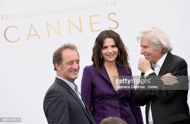 Vincent Lindon and Juliette Binoche attend the 70th Anniversary photocall during the 70th annual Cannes Film Festival at Palais des Festivals on May...
