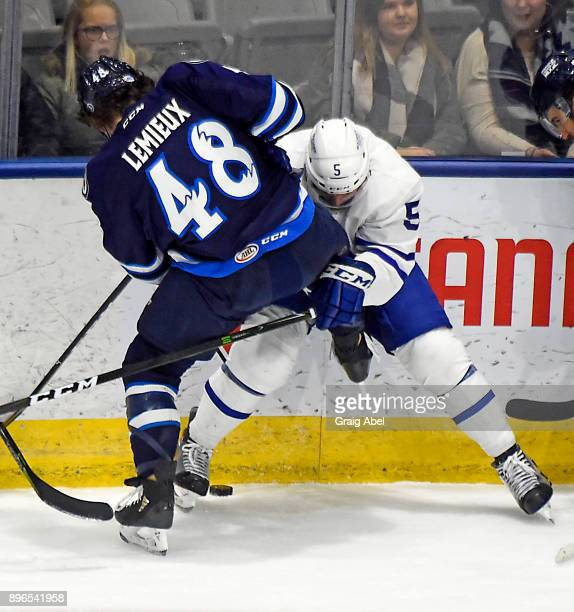 Vincent LoVerde of the Toronto Marlies ties up Brendan Lemieux of the Manitoba Moose during AHL game action on December 17 2017 at Ricoh Coliseum in...