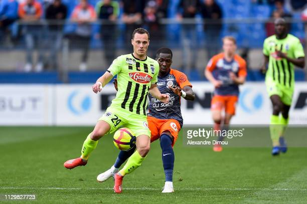 Vincent Manceau of Angers and Ambroise Oyongo of Montpellier during the Ligue 1 match between Montpellier and Angers at Stade de la Mosson on March...
