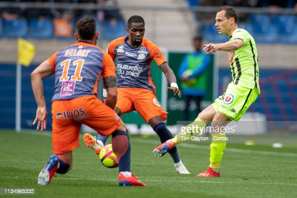 Vincent Manceau of Angers defended by Andy Delort of Montpellier and Ambroise Oyongo Bitolo of Montpellier during the Montpellier V Angers French...