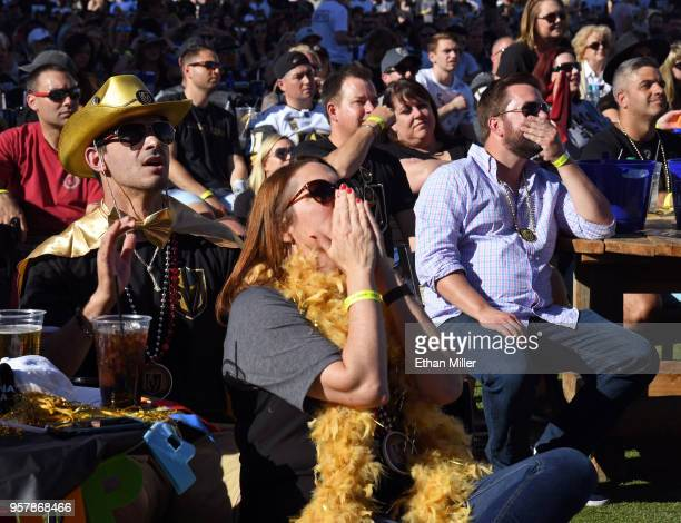 Vincent Mayo and his wife Allison Mayo , both of Nevada, look on during a Vegas Golden Knights road game watch party at the Downtown Las Vegas Events...