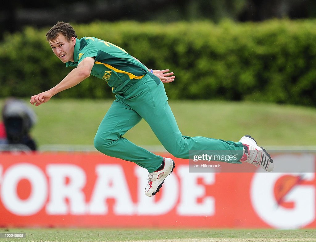 Vincent Moore of South Africa bowls during the ICC U19 Cricket World Cup 2012 Semi Final match between Australia and South Africa at Tony Ireland Stadium on August 21, 2012 in Townsville, Australia.