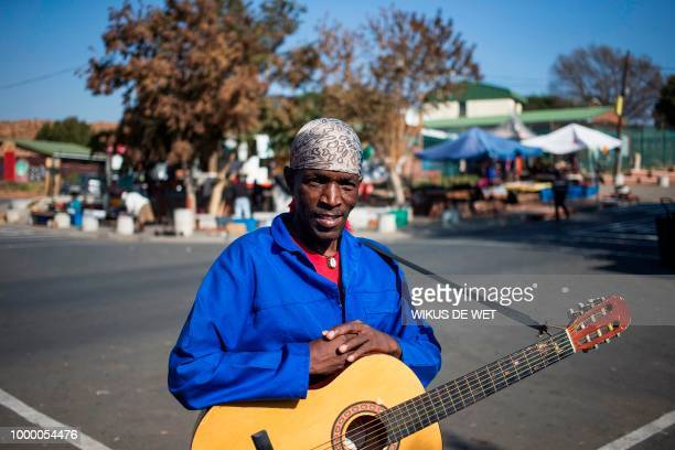 Vincent Ncabashe a street performer speaks about the legacy of antiapartheid icon Nelson Mandela in Soweto on July 11 2018 A black and white photo of...