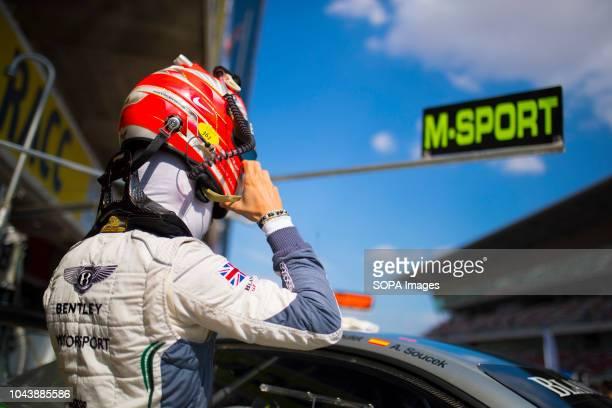 Vincent of Bentley team MSport Bentley Continental GT3 seen putting on a helmet before entering in the car during the race Circuit de...