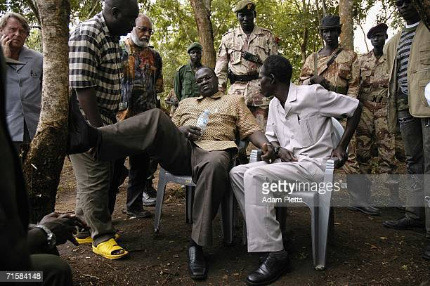 Vincent Otti , second in charge of the Lords Resistance Army speaks with Dr Riek Machar, vice president of Southern Sudan chat during peace talks on...