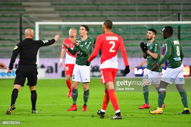 Vincent Pajot of St Etienne is lucky to escape a second yellow card from referee Amaury Delerue during the Ligue 1 match between AS SaintEtienne and...