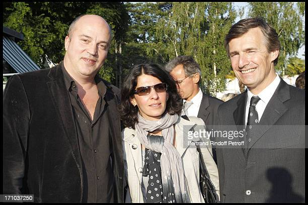 Vincent Parizot with his wife and Nicolas Beytout at Jardin D'Acclimatation 150th Anniversary With Les Echos Des Fanfares