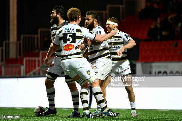 Vincent Pelo of La Rochelle celebrates with teammates after scoring a try during the Top 14 match between Oyonnax and La Rochelle on January 6 2018...
