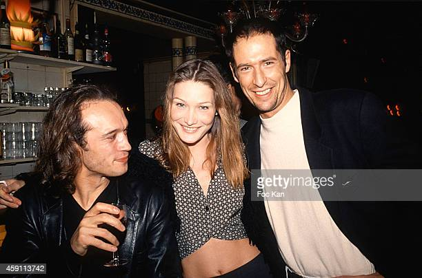 Vincent Perez Carla Bruni Sarkozy and Chris Martin attend a fashion week Party at Les Bains Douches in the 1990s in Paris France