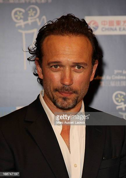 Vincent Perez poses for the premiere of 'So Young' during the Chinese Film Festival Day 2 at Cinema Gaumont Marignan on May 14 2013 in Paris France