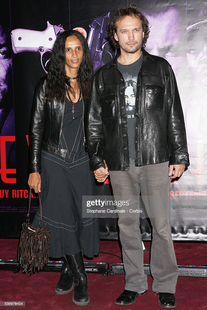 Vincent Perez with his wife Karine Sylla attend the premiere of 'Revolver' in Paris.