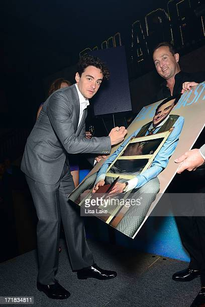 Vincent Piazza signs enlargement with John Colabelli during Philadelphia Style Magazine event for May/June 2013 issue featuring Vincent Piazza cover...