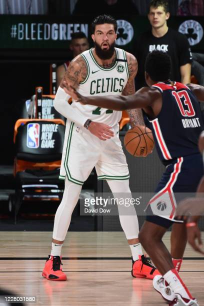 Vincent Poirier of the Boston Celtics looks to pass the ball against the Washington Wizards on August 13, 2020 at AdventHealth Arena in Orlando,...