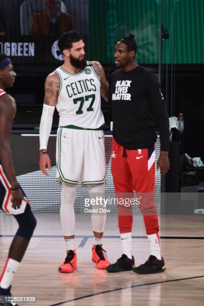 Vincent Poirier of the Boston Celtics shares a conversation with Ian Mahinmi of the Washington Wizards after the game on August 13, 2020 at...