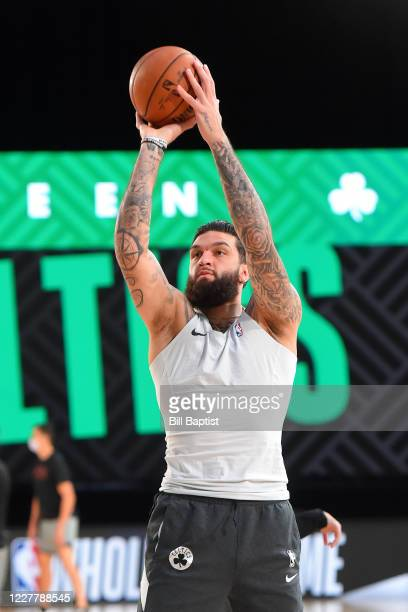 Vincent Poirier of the Boston Celtics warms up before a scrimmage against the Phoenix Suns on July 26, 2020 at HP Field House at ESPN Wide World of...