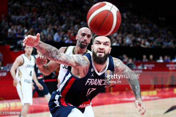 Vincent Poirier of the France National Team in action against Zaid Abbas of the Jordan National Team during the 1st round of 2019 FIBA World Cup at...