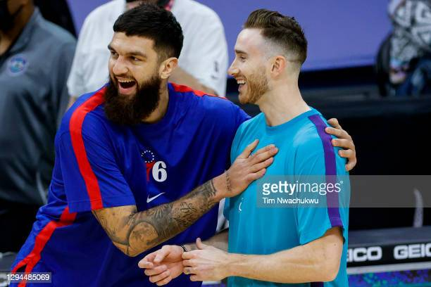 Vincent Poirier of the Philadelphia 76ers and Gordon Hayward of the Charlotte Hornets talk before a game at Wells Fargo Center on January 02, 2021 in...