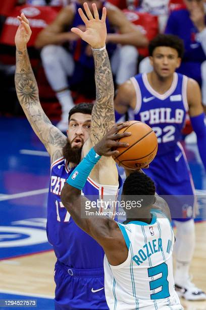 Vincent Poirier of the Philadelphia 76ers guards Terry Rozier of the Charlotte Hornets during the fourth quarter at Wells Fargo Center on January 04,...