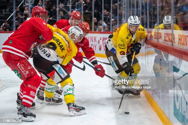 Vincent Praplan of SC Bern battles for the puck with Etienne Froidevaux of Lausanne HC during the Swiss National League game between Lausanne HC and...