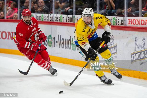 Vincent Praplan vies with Matteo Nodari of Lausanne HC during the Swiss National League game between Lausanne HC and SC Bern at Vaudoise Arena on...