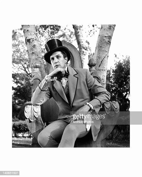 Vincent Price sitting on large outdoor throne in a scene from the film 'Dragonwyck', 1946.