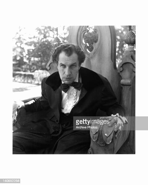 Vincent Price sitting on large outdoor throne in a scene from the film 'Dragonwyck' 1946