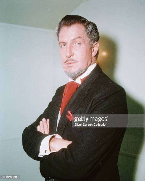Vincent Price , US actor, with a grey goatee beard, wearing a black jacket with a white shirt and a red cravat, with a red handkerchief in the breast...