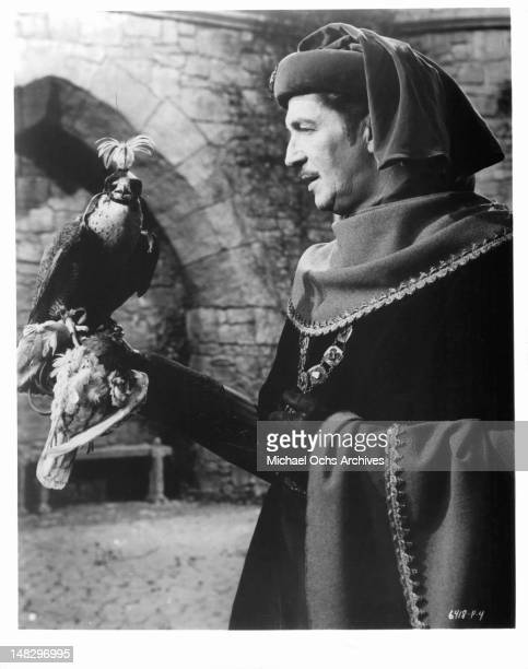 Vincent Price with a bird perched on his hand in a scene from the film 'The Masque of the Red Death' 1964