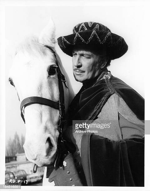 Vincent Price with a horse in a scene from the film 'The Masque Of The Red Death' 1964