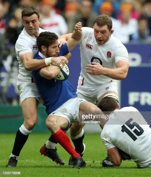 Vincent Rattez of France is held by George Ford Sam Underhill and George Furbank during the 2020 Guinness Six Nations match between France and...