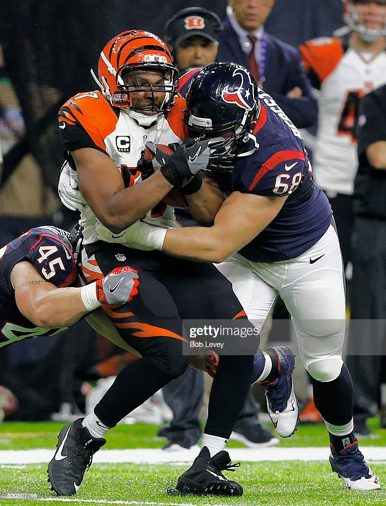 Vincent Rey #57 of the Cincinnati Bengals is tackled by Tony Bergstrom #68 of the Houston Texans and Jay Prosch #45 at NRG Stadium on December 24, 2016 in Houston, Texas.