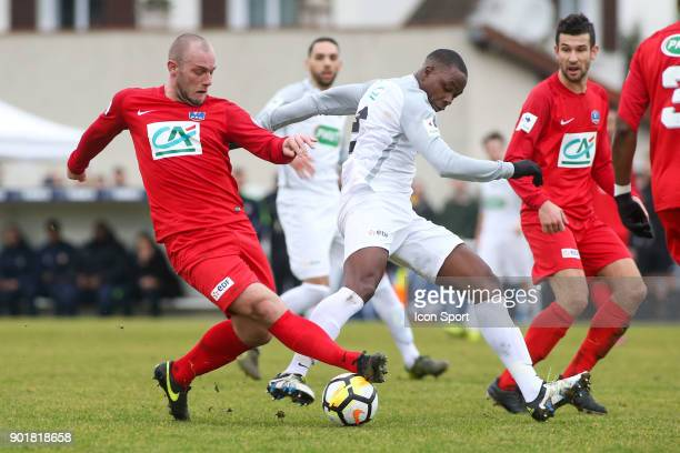 Vincent Richetin of Concarneau and Teddy Gadjard of Houilles during the french National Cup match between Houilles and Concarneau on January 6 2018...