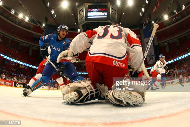 Vincent Rocco of Italy faisl to score over Jakub Stepanek . Goaltender of Czech Republic during the IIHF World Championship group S match between...