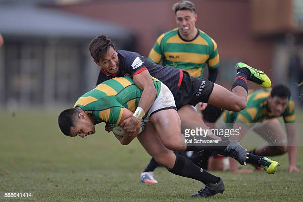 Vincent Sakaria of Wellington is tackled by Ben Volavola of the Cantabrians during the rugby match between the Cantabrians and Wellington at Rugby...