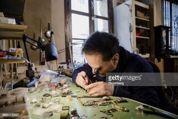 Vincent Talay a watchmaker examines a watch at his workshop in Donzy France on Wednesday March 22 2017 Since 1981 the townsfolk of Donzy have voted...