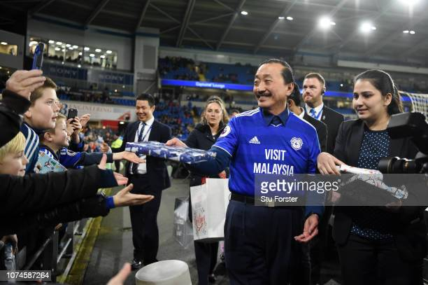Vincent Tan owner of Cardiff City hands out Christmas presents to fans prior to the Premier League match between Cardiff City and Manchester United...