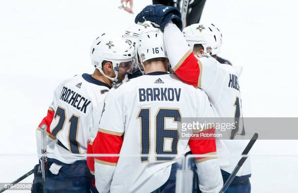 Vincent Trocheck Aleksander Barkov and Jonathan Huberdeau of the Florida Panthers celebrate with teammates after Trocheck scored a secondperiod goal...
