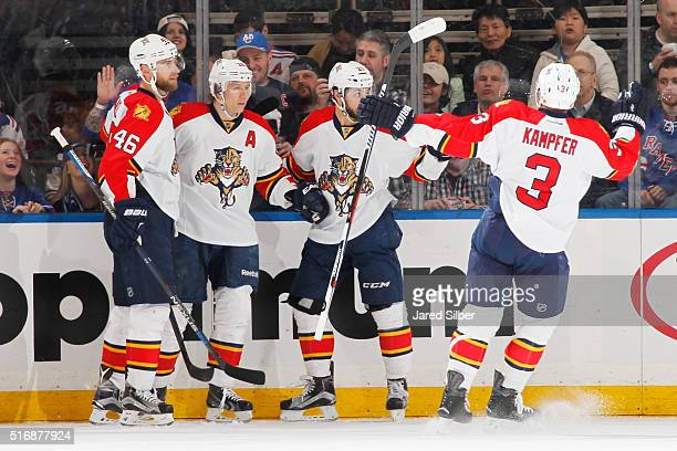 Vincent Trocheck Jussi Jokinen Steven Kampfer and Jakub Kindl of the Florida Panthers celebrate after a goal in the third period against the New York...