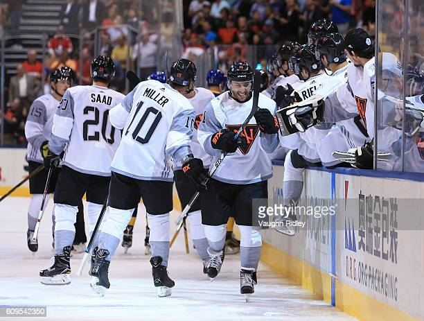 Vincent Trocheck of Team North America high fives the bench after scoring a first period goal on Team Sweden during the World Cup of Hockey 2016 at...
