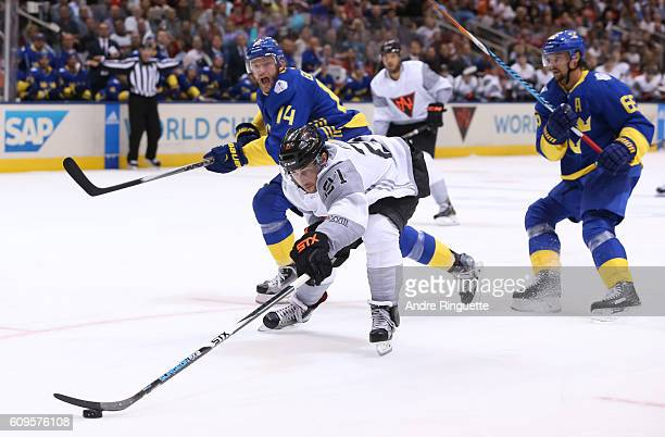 Vincent Trocheck of Team North America reaches for a loose puck against Team Sweden during the World Cup of Hockey 2016 at Air Canada Centre on...