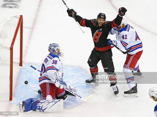 Vincent Trocheck of the Carolina Hurricanes celebrates a shorthanded goal by Martin Necas against Henrik Lundqvist of the New York Rangers at 1051 of...