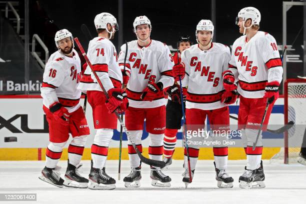 Vincent Trocheck of the Carolina Hurricanes celebrates with teammates after scoring a goal in the first period against the Chicago Blackhawks at the...