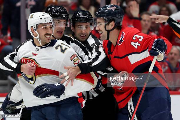 Vincent Trocheck of the Florida Panthers and Tom Wilson of the Washington Capitals are separated in the first period at Capital One Arena on November...