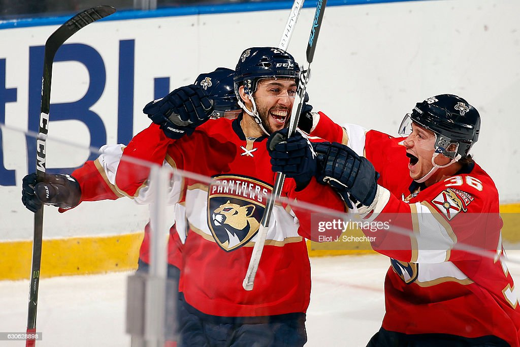 Vincent Trocheck #21 of the Florida Panthers celebrates his goal with teammate Jussi Jokinen #36 against the Toronto Maple Leafs at the BB&T Center on December 28, 2016 in Sunrise, Florida.